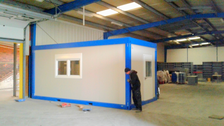 Delivery of a container office inside