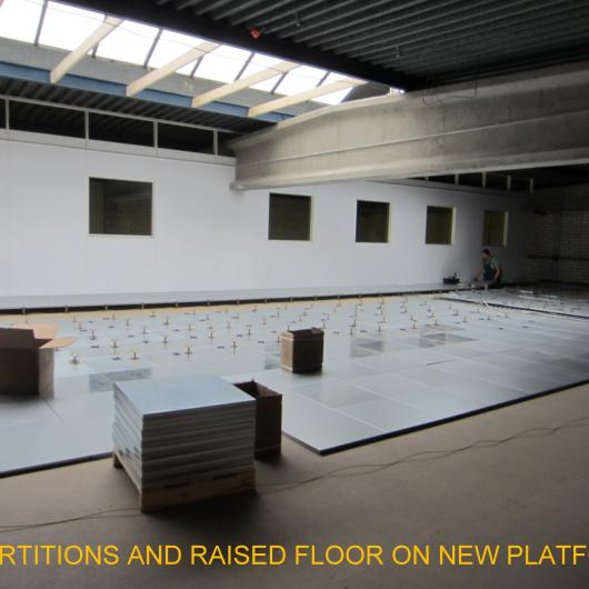 Partitions and raised floor on platform